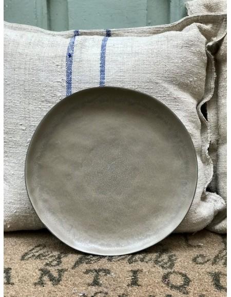 Bajo plato de gres porcelánico