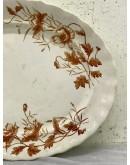 Gran fuente de porcelana con decoración floral de corte modernista.